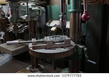 Part machining with drilling machine #1379777783