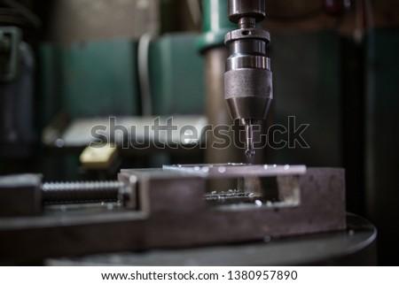 Part machining with drilling machine #1380957890