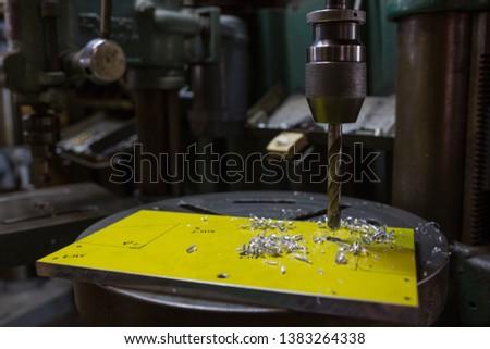 Part machining with drilling machine #1383264338