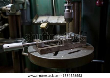 Part machining with drilling machine