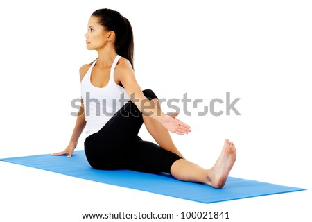 Part of a collection of yoga poses by a fit active hispanic woman; half spinal twist