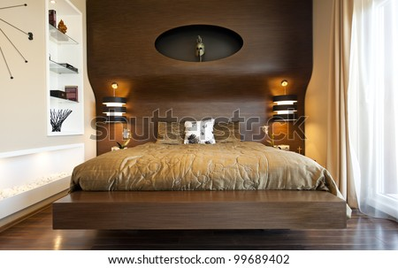 Part Of A Design Bedroom With An Ancient Greek Mask And Pillows