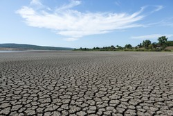 Part of a huge area of dried land suffering from drought in cracks.