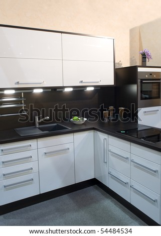 Part of a modern kitchen in black and white
