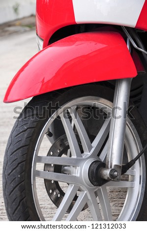 Part of a motorcycle and car wheel