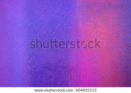 Part of a stone wall with colorful paint marks, paint texture, paint sprayed wall with colorful stains and flowing paint