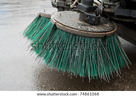 part of a street cleaning vehicle