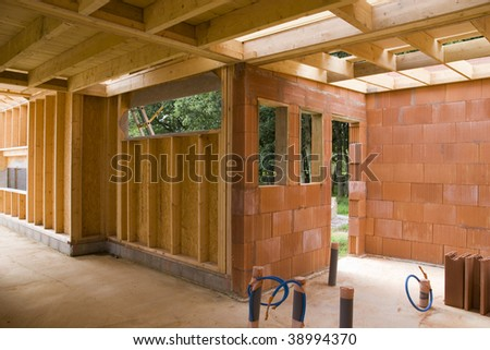 part of a wood and brick house construction