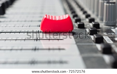 Part of an audio sound mixer with big red button
