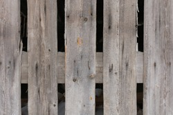 Part of an old gray wooden fence. Wood texture. Horizontal photo