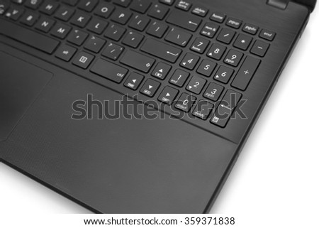 Part of black opened laptop with empty screen isolated on white background closeup #359371838