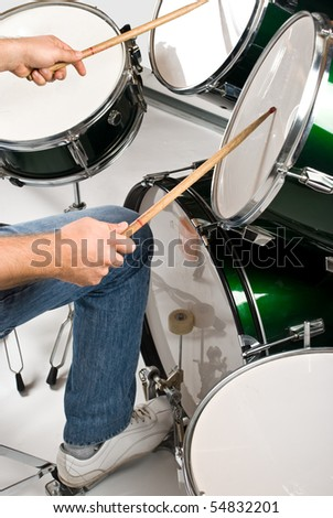 Part of body drummer playing on drum set