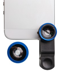 Part of cell phone with clip lens kit isolated on white. Kit includes two lenses and clip. Flat lay. Top view.