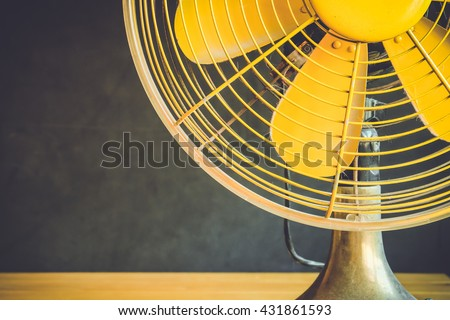 Part of electric fan on a table dark background  #431861593