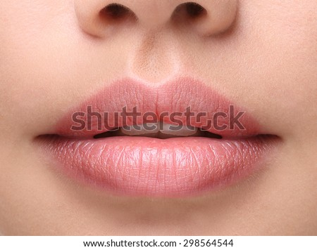 Part of face,young woman close up. Sexy plump lips without makeup #298564544