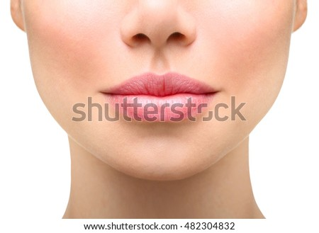 Part of face,young woman close up. Sexy plump lips without makeup #482304832