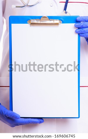 Part of female body in white lab coat. Doctor or nurse holding blank copy space clipboard isolated. Medical person for health insurance. - stock photo