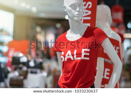 Part of female mannequin dressed in casual clothes with sale text in the shopping department store for shopping, business fashion and advertisement concept