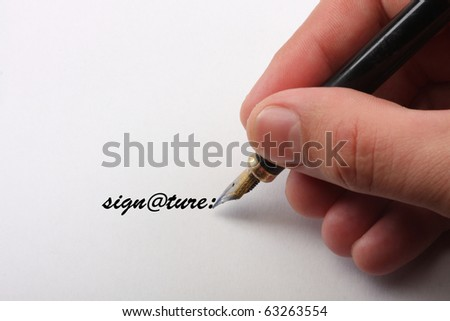 part of hands signing a contract