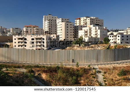 Part of Israeli security fence near Jerusalem separating west bank.