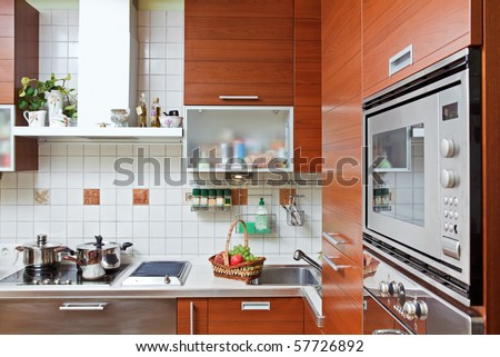Part of Kitchen interior with wooden furniture and build in microwave oven