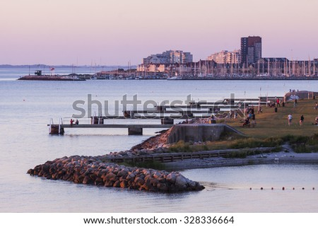 Part of Malmoe Sweden with the beach and the jetties when sunset in May