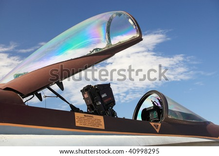 Part of military jet on the background of blue sky
