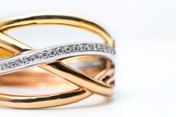 part of modern design gold bangle with diamond on white background