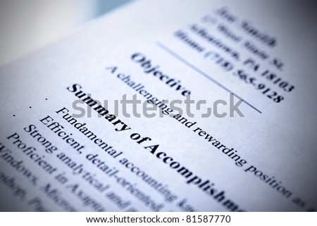 Part of modern resume close-up. Blue tint with shallow DOF. Tilt view.