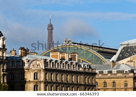 Part of Musee d'Orsay, Parisian buildings and Eiffel Tower.