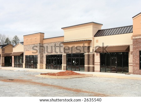 "Part of my ""instant village"" set.  A new suburban shopping center under construction in Atlanta.  Earth tone materials.  Made to resemble a small village main street."