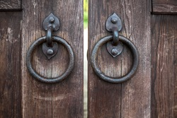 Part of oak doors with wrought iron handles in the form of rings