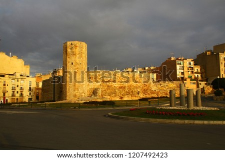 Part of Old town with defensive walls of Circo romano (Roman Circus) in spanish city Tarragona in Western Catalonia in morning. Remnants of Roman ruins. It's one of best-preserved circuses in West.