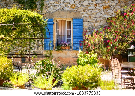 Part of provencal house of small typical town in Provence, France. Beautiful village, with french cute details on summer day. Outdoors, exteriors. Stock photo ©