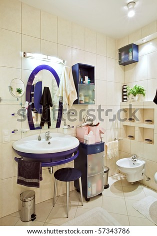 Part of small modern bathroom interior with blue wash stand