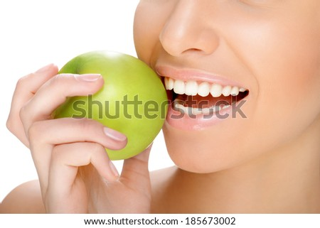 part of the face close-up toothy smile with green apple