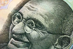 part of the Indian paper money - a portrait of Mahatma Gandhi
