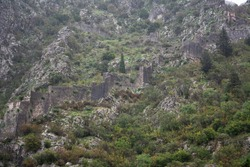 Part of the old fortress wall in the mountains in Kotor, Montenegro