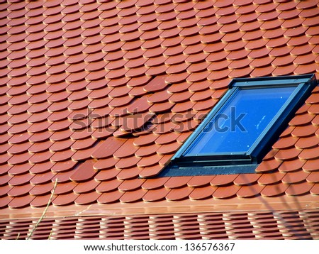 part of the red roofs of wrongly laid tile - error in execution of construction works