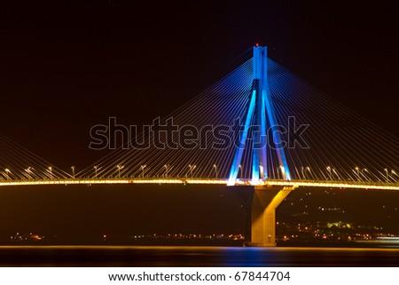 Part of the Rio-Antirio suspension bridge illuminated during the night, Greece #67844704