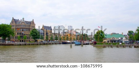 part of the skyline of rotterdam seen from the maas river
