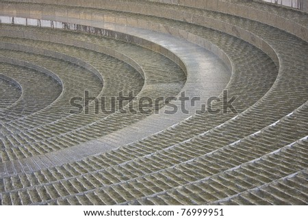 "Part of the ""Spiral Fountain"" in Darling Harbour, Sydney, Australia. Water flows over the grooved concentric steps"