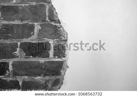 Part of the wall of the ancient house with modern decoration white plaster. Black and white background. The concept of antiquity style. #1068563732
