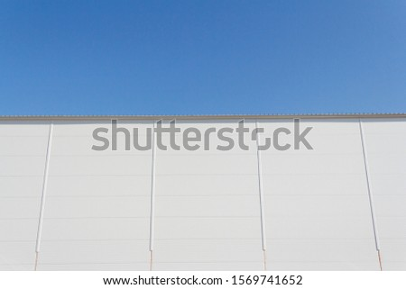 Part of the wall of the building made of sandwich panels. Sandwich panels with insulation in the construction of buildings.