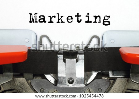 Part of typing machine with typed Marketing word #1025454478