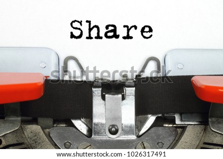 Part of typing machine with typed Share word #1026317491