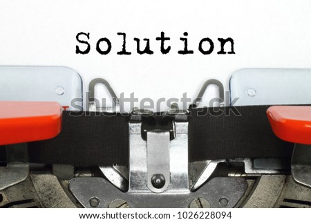 Part of typing machine with typed Solution word #1026228094
