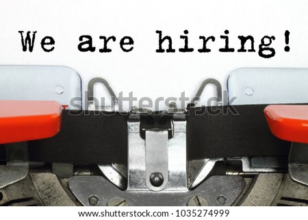 Part of typing machine with typed We are Hiring words close-up #1035274999