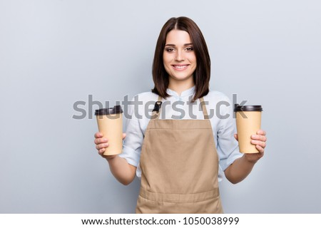 Part-time job person owner cacao routine lifestyle rest break relax leisure pause concept. Portrait of kind friendly pleasant girl giving two big latte isolated on gray background copy-space #1050038999