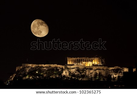 Parthenon on Acropolis Hill of Athens by night with almost full moon